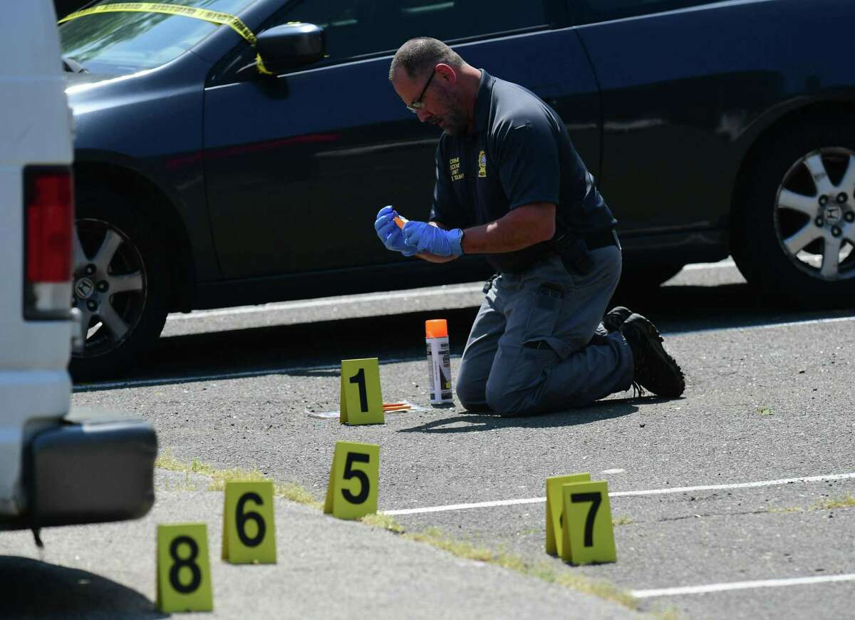 Norwalk police investigate a shooting at Colonial Village Thursday, may 20, 2021, in Norwalk, Conn.