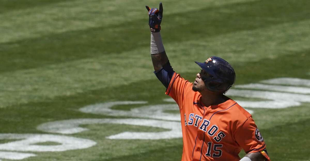 Houston Astros' Martin Maldonado (15) celebrates after hitting a two-run home run against the Oakland Athletics during the fourth inning of a baseball game in Oakland, Calif., Thursday, May 20, 2021. (AP Photo/Jeff Chiu)