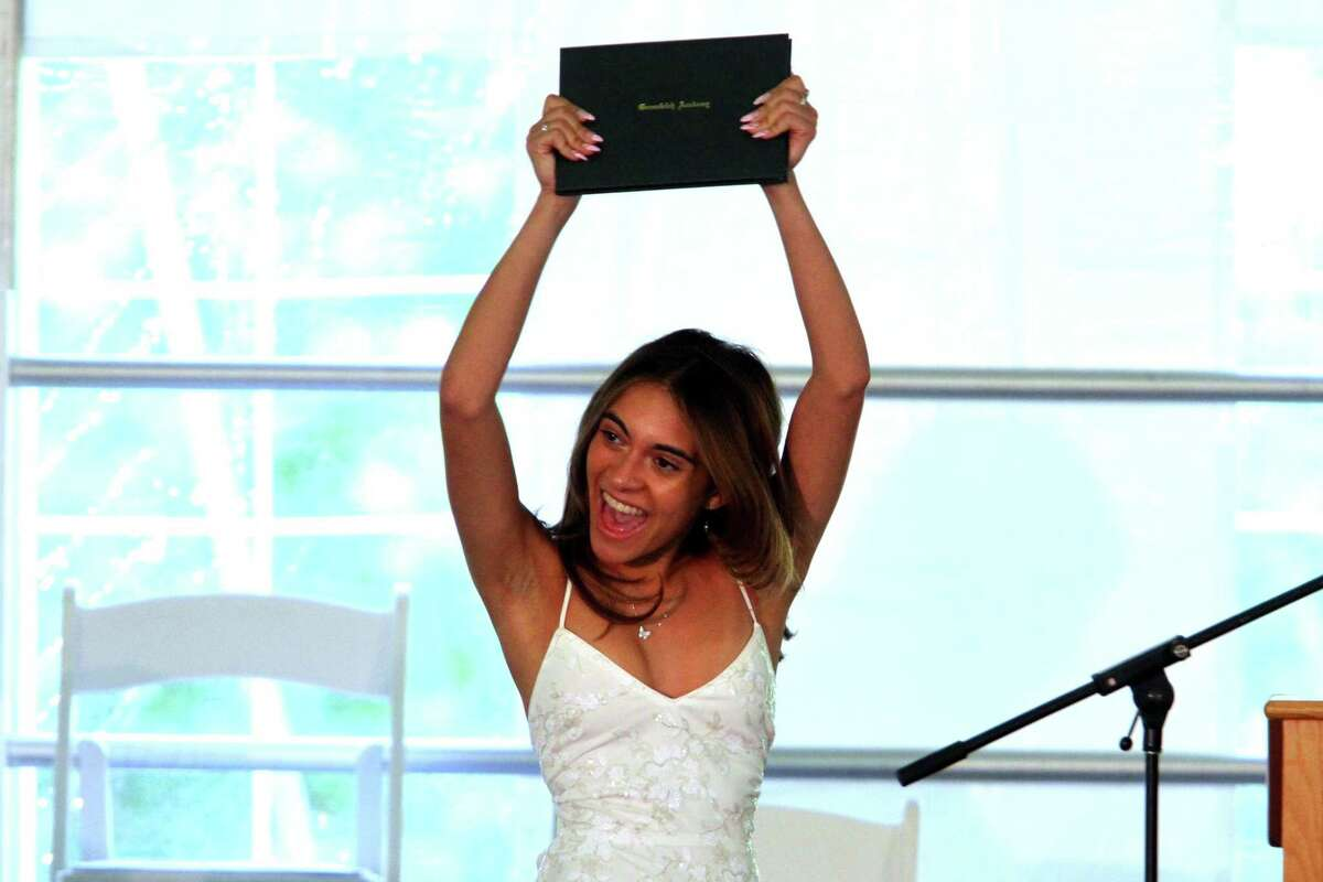 Graduate Jalinette Reyes celebrates getting her diploma during the Greenwich Academy Commencement.