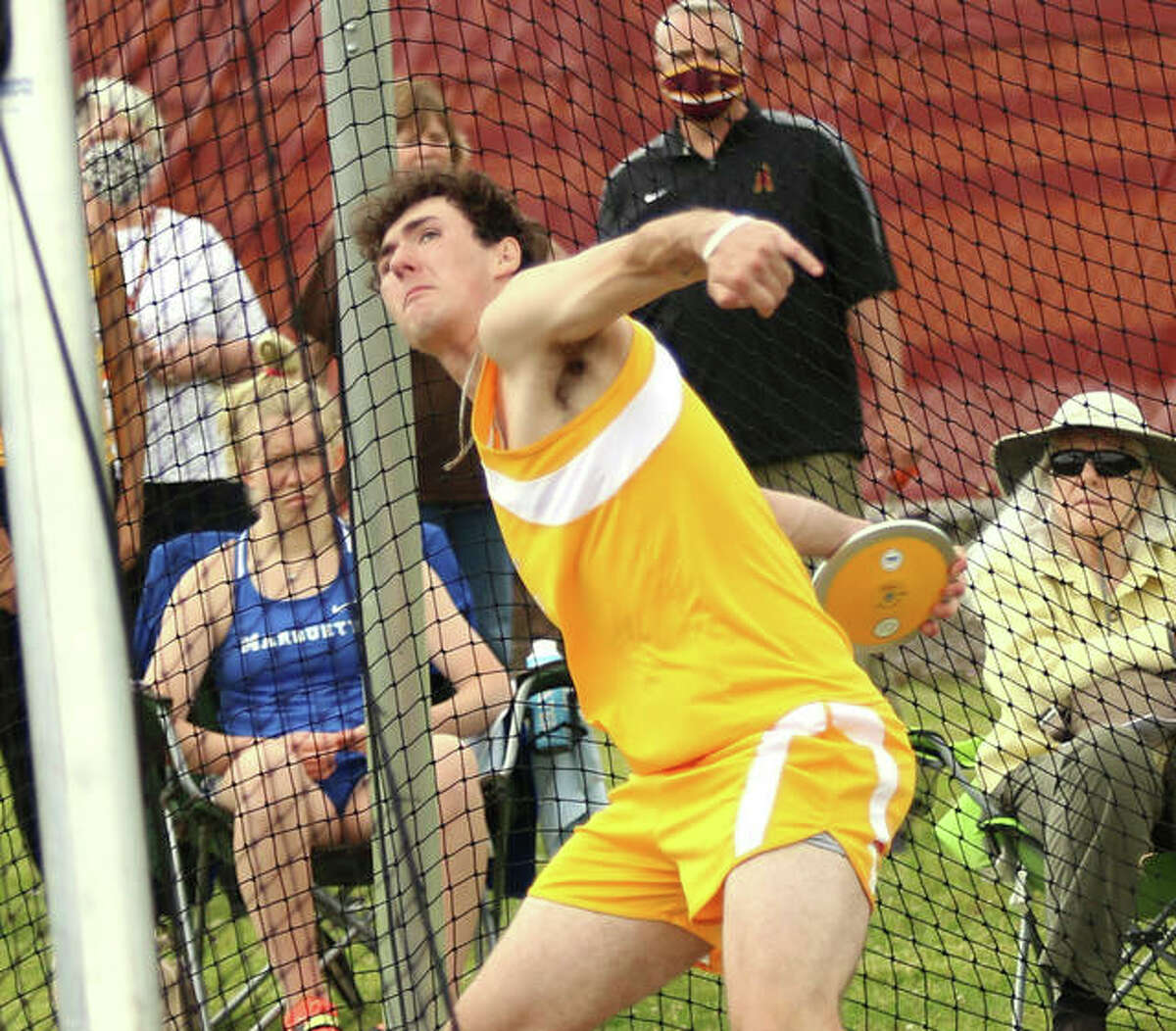 EA-WR's Evan Merritt throws the discus in the Madison County Small-Schools Meet on Monday in Wood River. On Wednesday, Merritt won the discus and the shot to help the Oilers win the Prairie State Conference boys meet in Wood River.