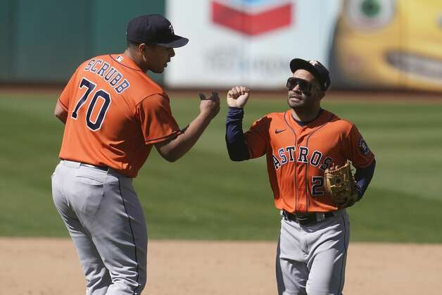 Houston Astros pitcher Andre Scrubb (70) celebrates with second baseman Jose Altuve after the Astros defeated the Oakland Athletics 8-4 in a baseball game in Oakland, Calif., Thursday, May 20, 2021. (AP Photo/Jeff Chiu) Photo: Jeff Chiu/Associated Press / Copyright 2021 The Associated Press. All rights reserved