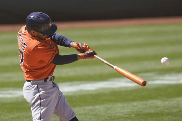 Houston Astros' Jose Altuve hits a single against the Oakland Athletics during the ninth inning of a baseball game in Oakland, Calif., Thursday, May 20, 2021. (AP Photo/Jeff Chiu) Photo: Jeff Chiu/Associated Press / Copyright 2021 The Associated Press. All rights reserved