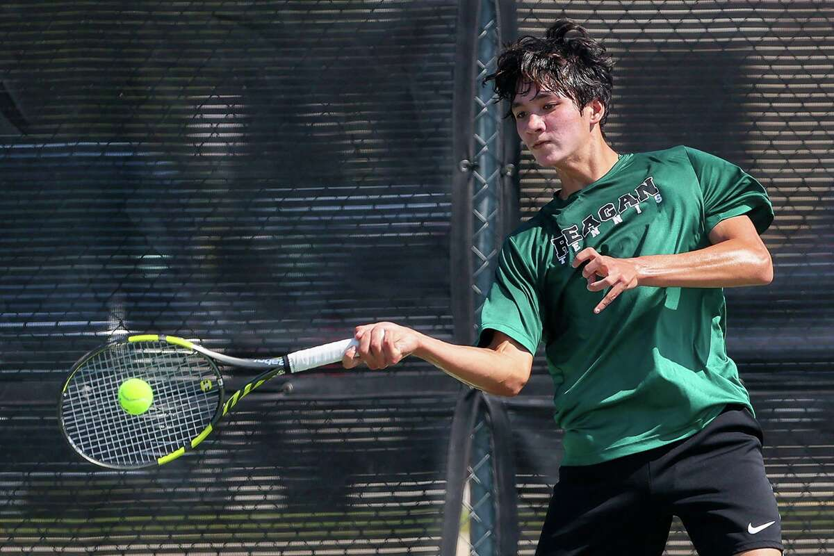 Reagan's Ryan Totorica returns a shot while playing in 6A boys singles against Conroe The Woodlands' Aidan Lee during the first day of the UIL state tennis tournament at the Northside Tennis Center on Thursday, May 20, 2021. Totorica beat Lee 6-1, 4-6, 7-6 (7).