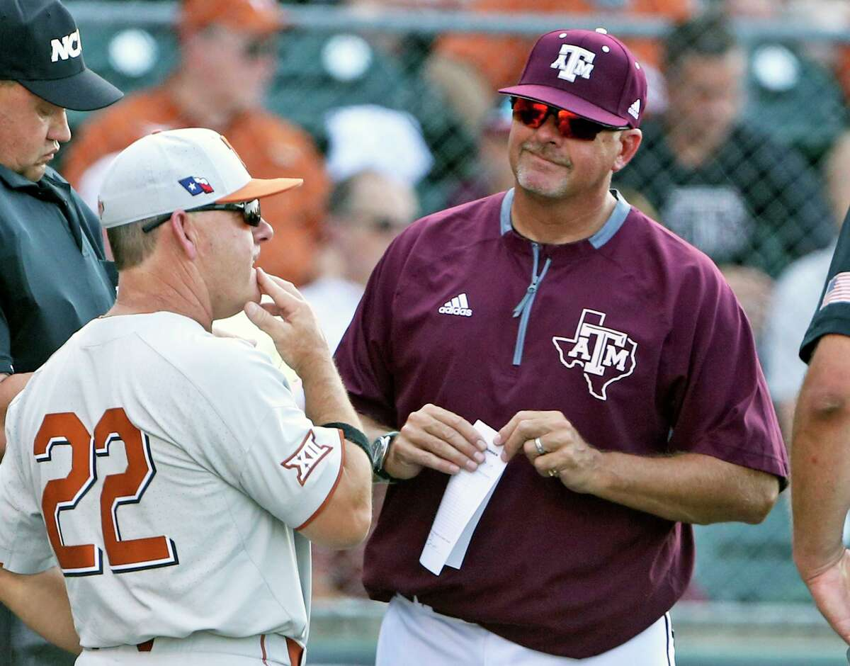 Texas, coached by David Pierce (22), and Texas A&M, coached by Rob Childress, faced each other in an NCAA baseball regional at Austin's Disch-Falk Field in 2018. The Longhorns won that game, but the Aggies are 5-4 against UT since joining the Southeastern Conference.