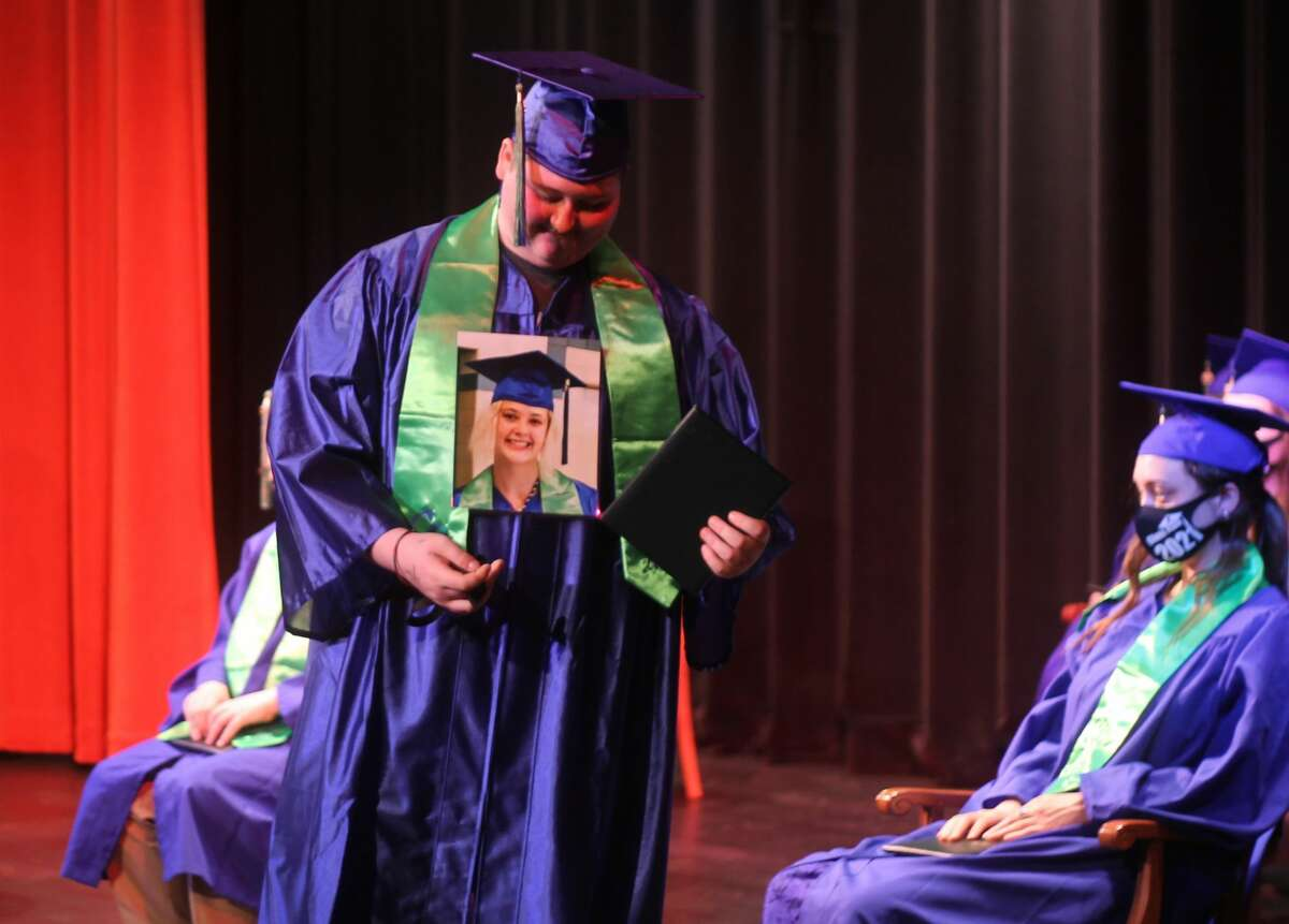 CASMAN Academy graduate Dakota Ogletree walks across the stage during a graduation ceremony at the Ramsdell Theatre Thursday evening.