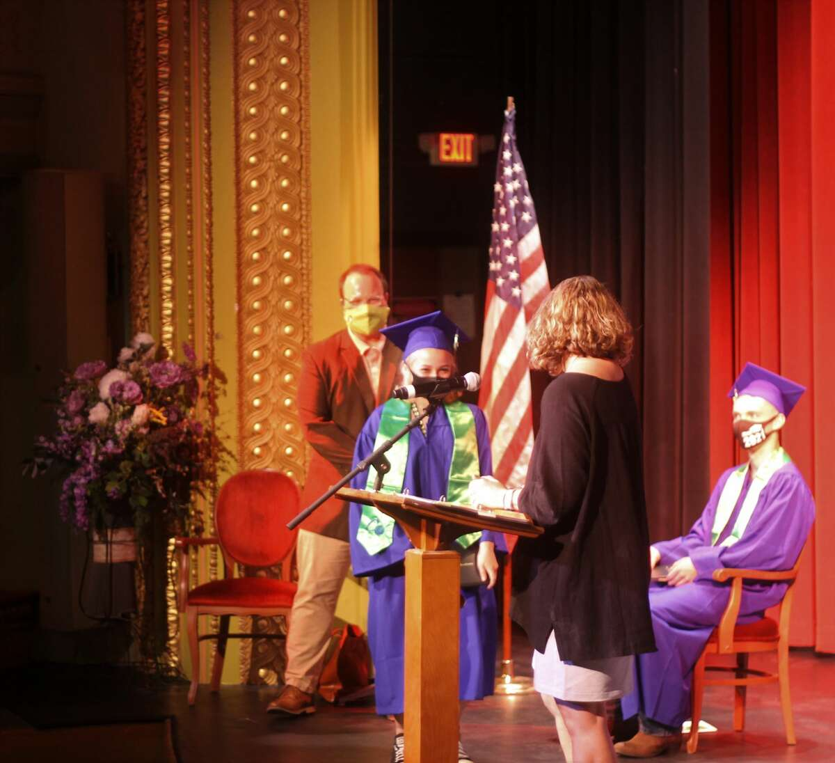 CASMAN Academy graduate Lita Shepard walks across the stage after receiving her diploma during a graduation ceremony at the Ramsdell Theatre on Thursday.