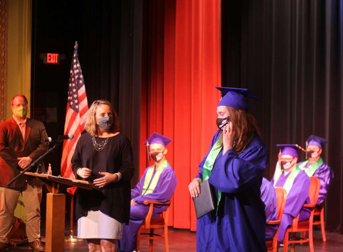 CASMAN Academy graduate Angela Eddy poses for a photo after receiving her diploma during a graduation ceremony at the Ramsdell Theatre on Thursday.