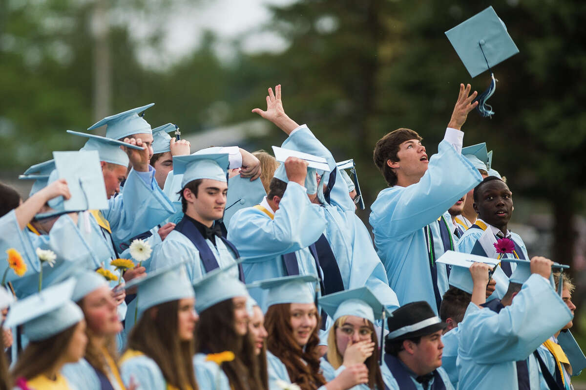 The Meridian Early College High School Class of 2021 toss their caps in the air as they celebrate with a commencement ceremony Thursday, May 20, 2021 at the school in Sanford. (Katy Kildee/kkildee@mdn.net)