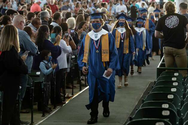 Class salutatorian Easton James Havemann leads a line of graduates onto the stage area during Oak Ridge High School's graduation ceremony at the Cynthia Woods Mitchell Pavilion on Thursday in The Woodlands Photo: Gustavo Huerta, Houston Chronicle / Staff Photographer / Houston Chronicle © 2021