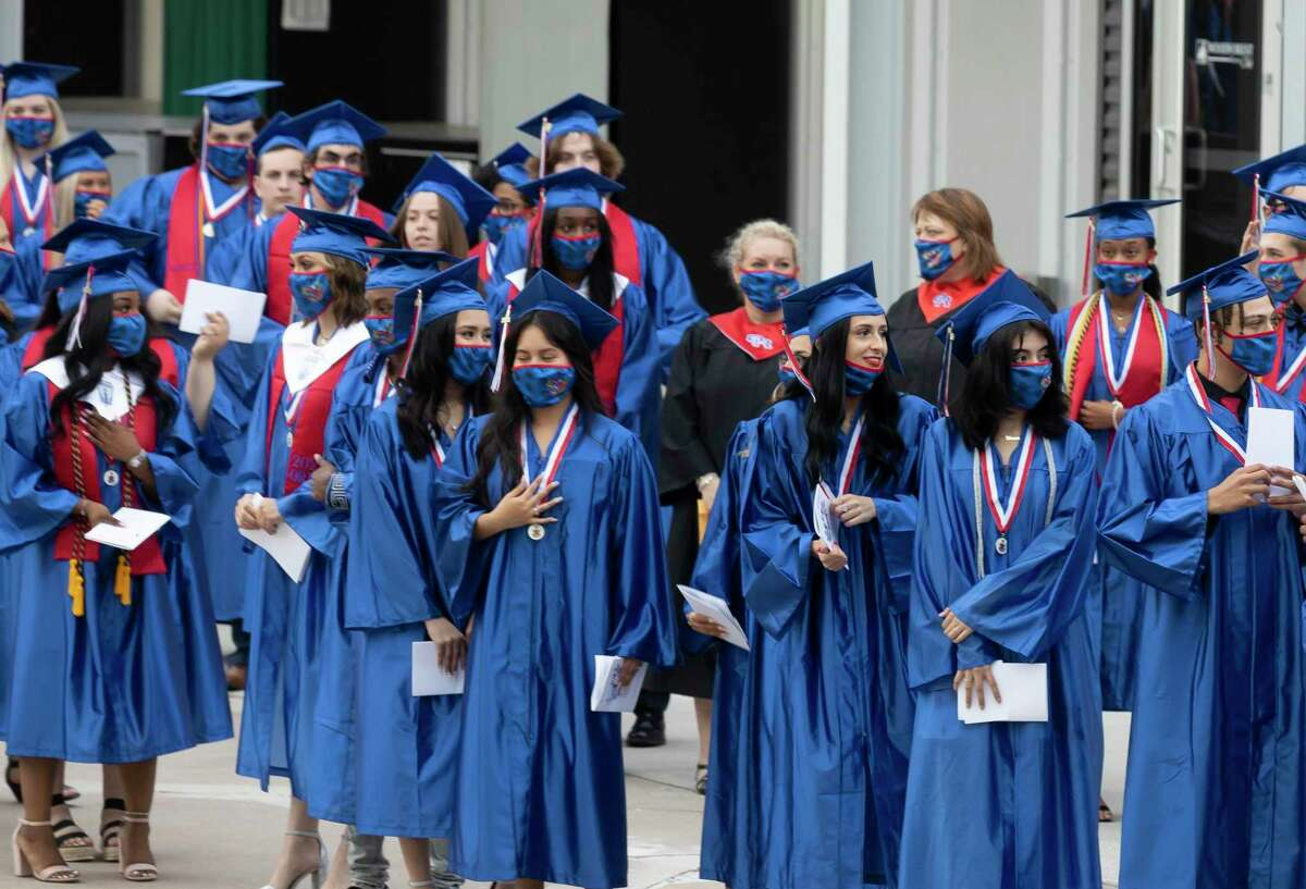 Graduates lineup before Oak Ridge High School's graduation ceremony at the Cynthia Woods Mitchell Pavilion, Thursday, May 20, 2021, in The Woodlands.