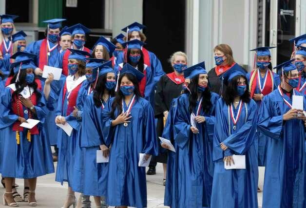 Graduates lineup before Oak Ridge High School's graduation ceremony at the Cynthia Woods Mitchell Pavilion, Thursday, May 20, 2021, in The Woodlands. Photo: Gustavo Huerta, Houston Chronicle / Staff Photographer / Houston Chronicle © 2021
