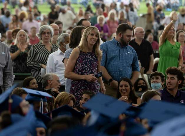 Parents of graduates stand during Oak Ridge High School's graduation ceremony at the Cynthia Woods Mitchell Pavilion, Thursday, May 20, 2021, in The Woodlands. Photo: Gustavo Huerta, Houston Chronicle / Staff Photographer / Houston Chronicle © 2021