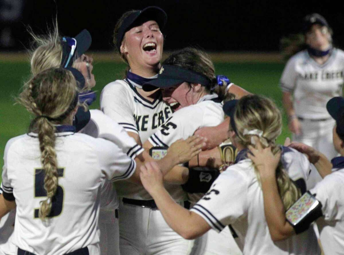 Lake Creek relief pitcher Emiley Kennedy celebrates with starting pitcher Ava Brown after the final out in the seventh inning to win a one-game Region III-5A semifinal against Crosby 2-1 at Grand Oak High School, Thursday, May 20, 2021, in Spring.
