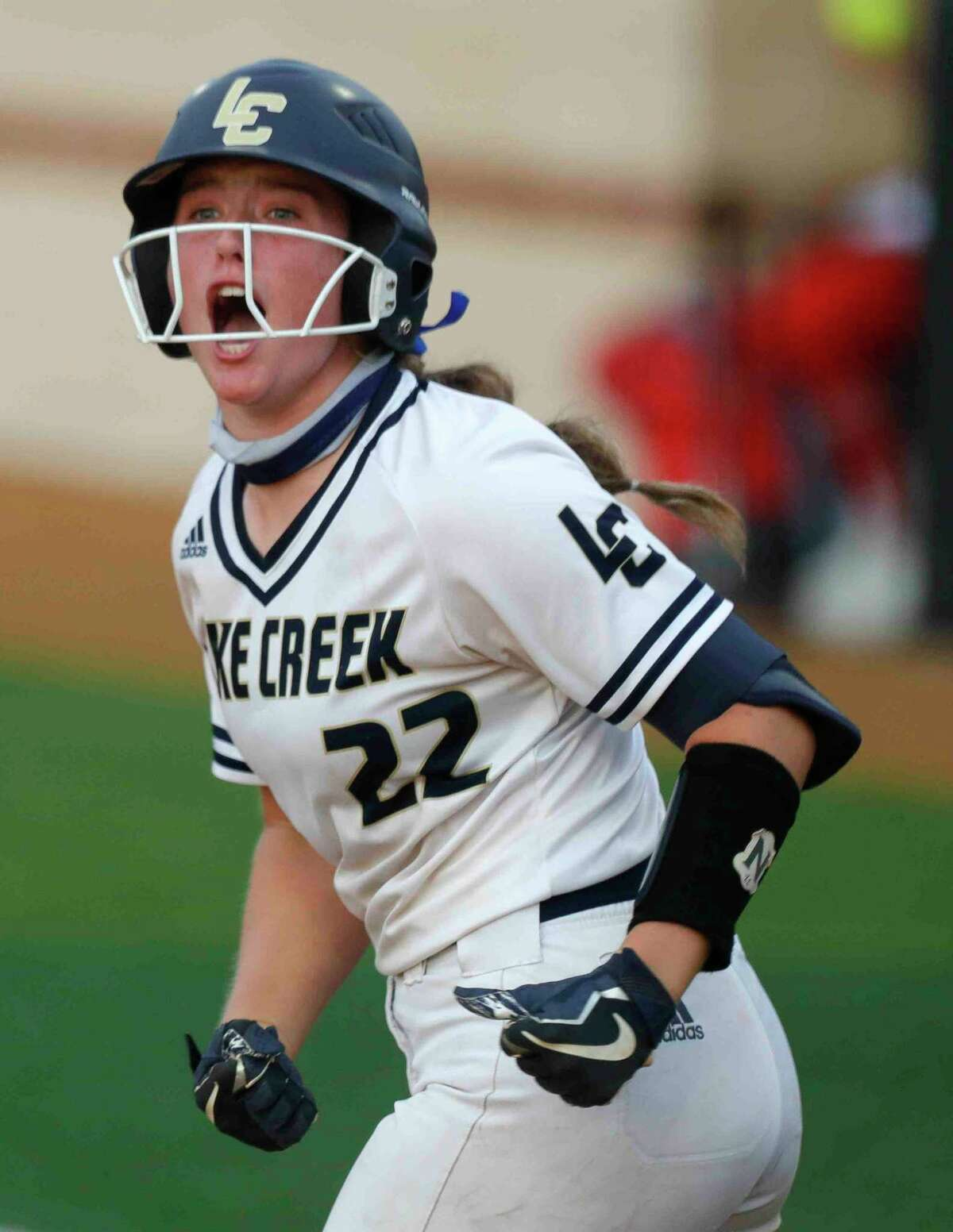 Ava Brown #22 of Lake Creek reacts after drawing a walk during a one-game Region III-5A semifinal at Grand Oak High School, Thursday, May 20, 2021, in Spring.