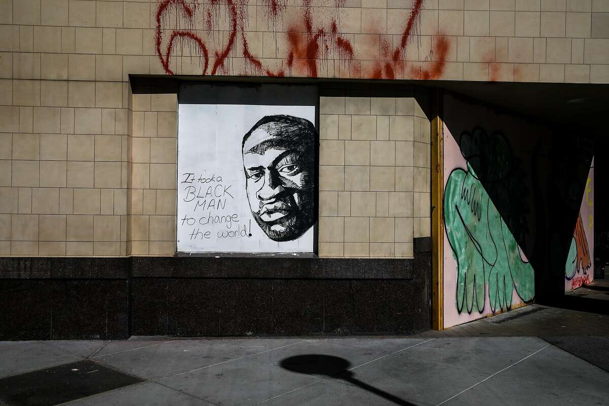 A mural depicting George Floyd's image hangs at the corner of 14th and Broadway on Thursday, June 4, 2020, in Oakland, Calif. Floyd was killed by former police officer Derek Chauvin in Minneapolis on May 25, 2020. Chauvin was recently found guilty by a jury in Floyd's murder.