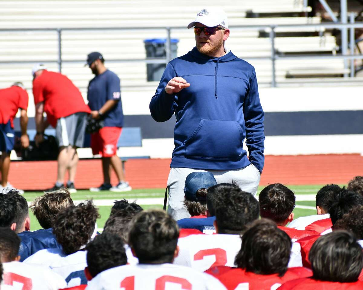 Head coach Johnathon Haddock talks to members of the Plainview football team follow the spring game.