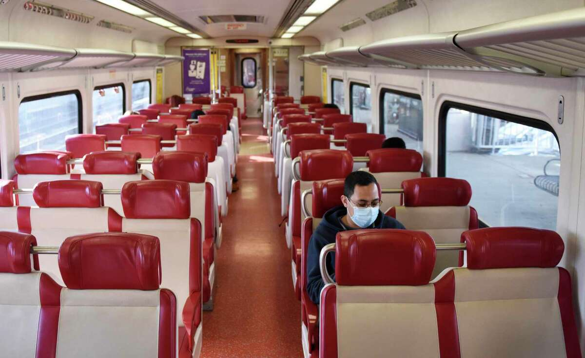 Metro-North passengers ride the local train between Greenwich and Stamford, Conn. on Tuesday, Dec. 1, 2020.