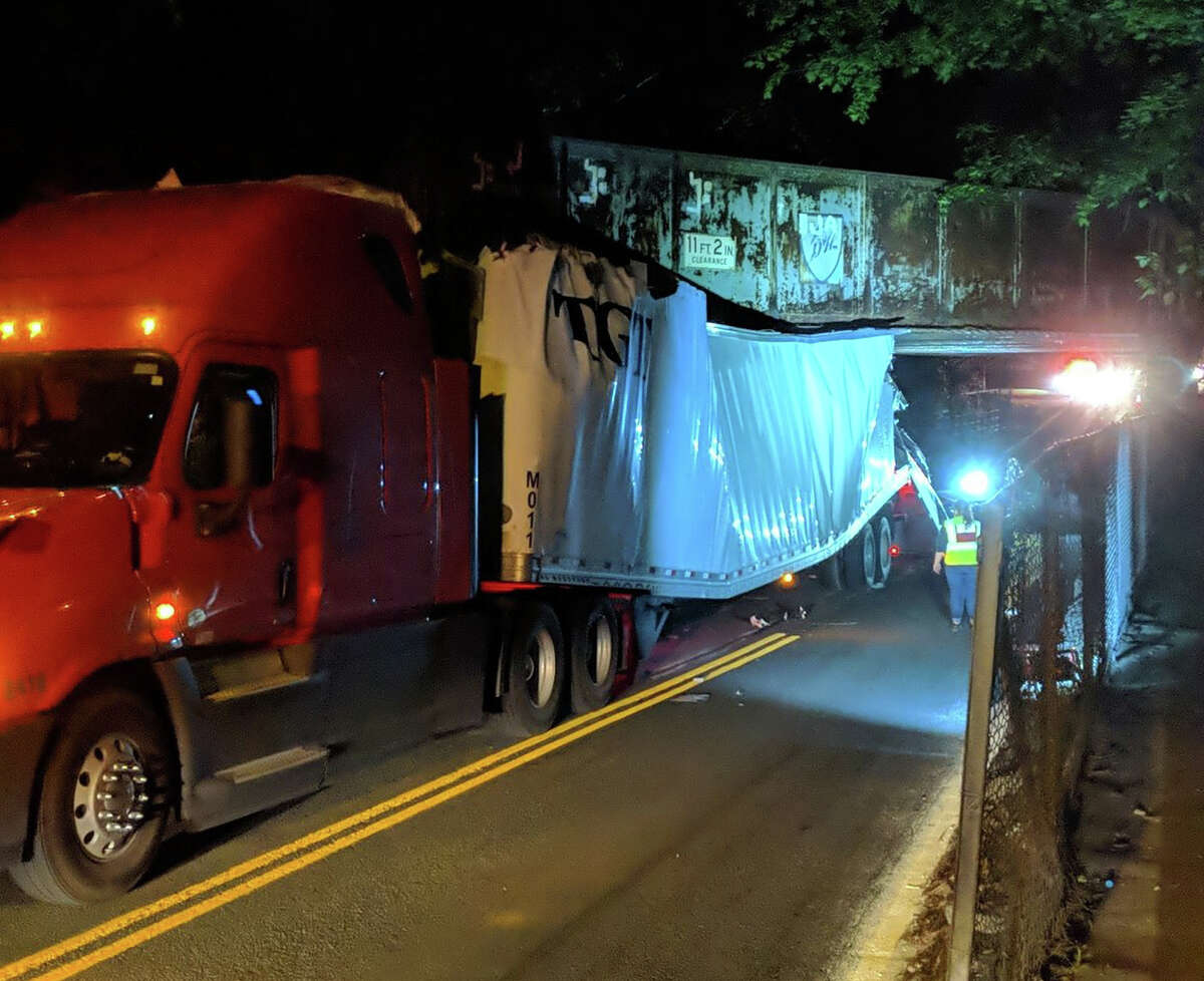 A main route through Bethlehem will be closed for an extended period of time, according to Bethlehem Police after a tractor-trailer struck and became wedged under a bridge in Slingerlands.
