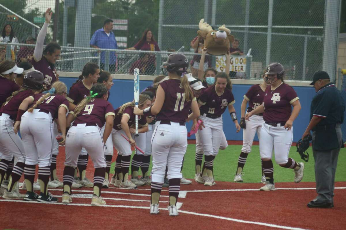 Addison Lehew gets ready to be mobbed at home plate after her home run in the third inning made it 13-1.