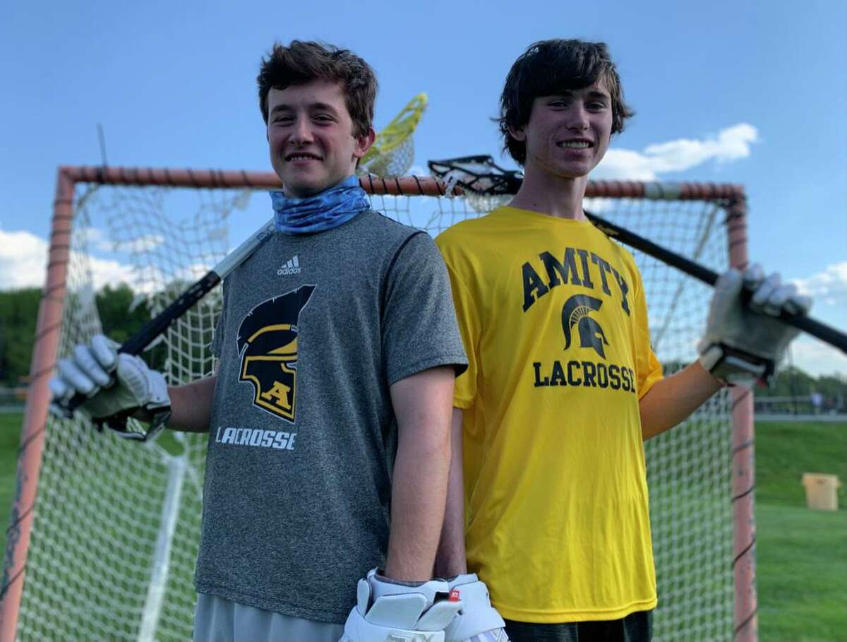 Jack Coughlin, left, transferred to Amity to play two years of lacrosse and a season of football with his brother Patrick.