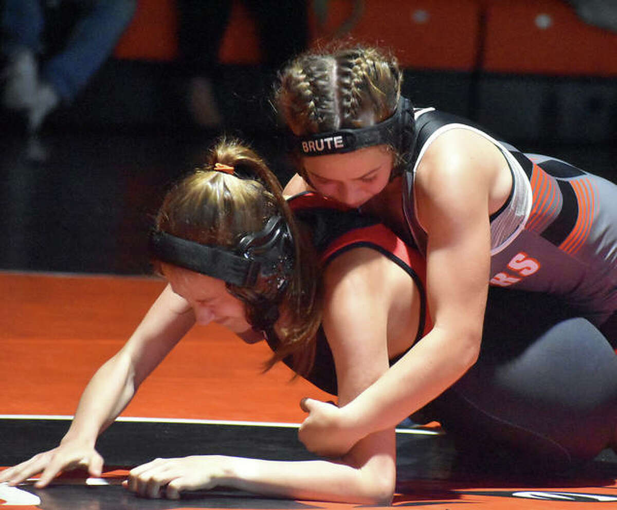 Edwardsville's Olivia Coll, top, in control of her 106-pound match.