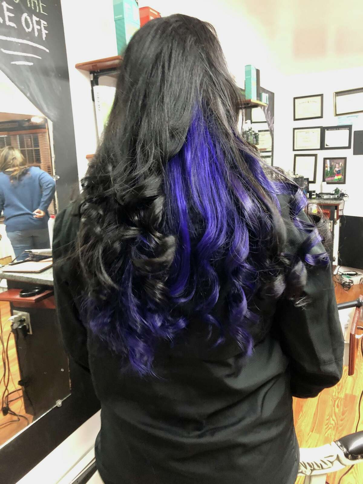 Owner of Main Switch Salon Sonia Santavenere said as the COVID-19 pandemic waned, customers were coming in to her Middletown and Norwalk locations requesting drastic changes, like this one customer who dyed the underside of her hair purple.