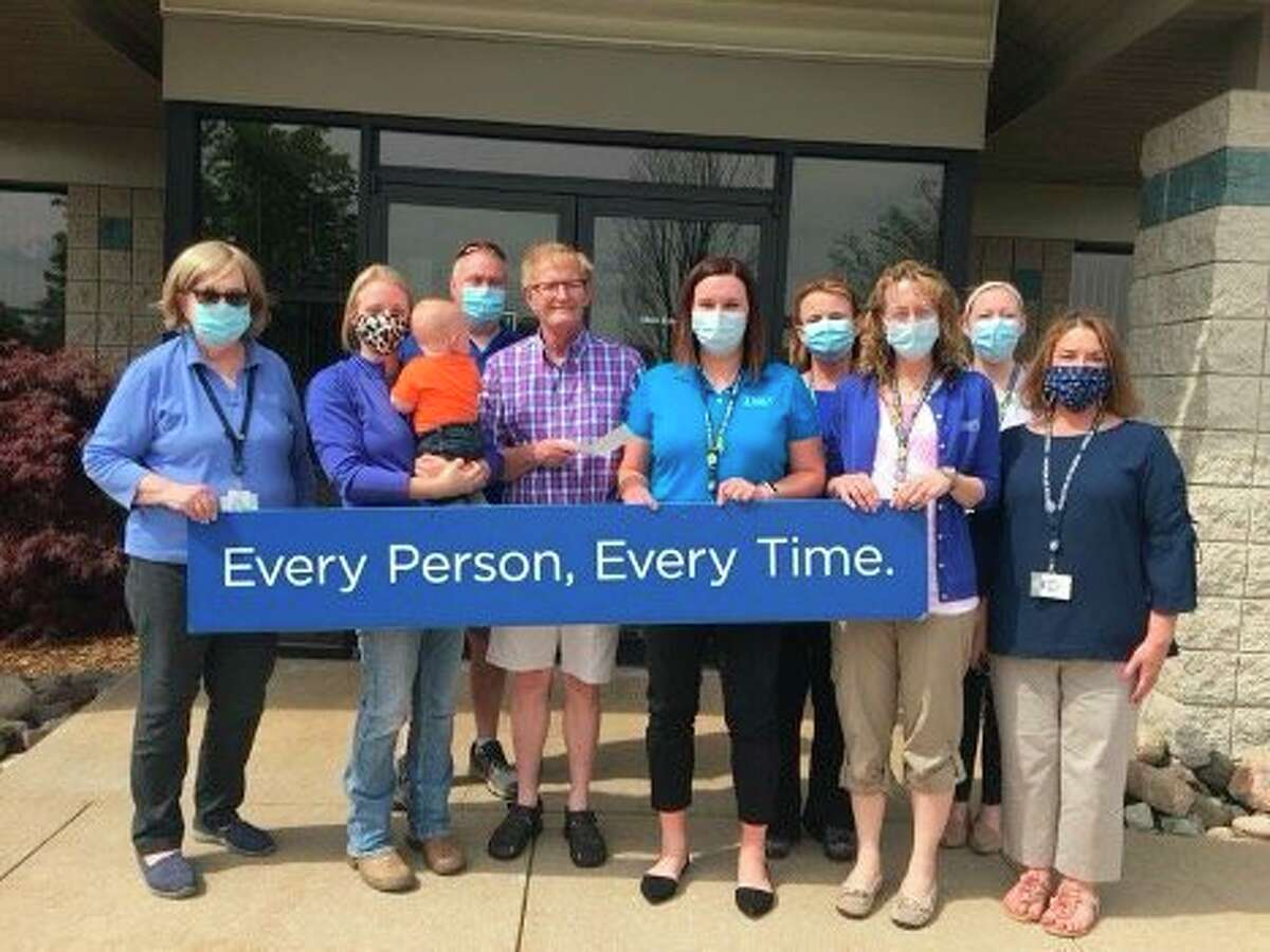 Pictured from the left are Hospice members Kaye Ferguson-Patton, Cameron Aris, Tim Bedker, Lodge member Bruce Parker, Hospice members Danielle Knight, Krisly Mieras, Ramona Hancock, Jena Stombaugh, and Michelle Gallager. (Courtesy photo)