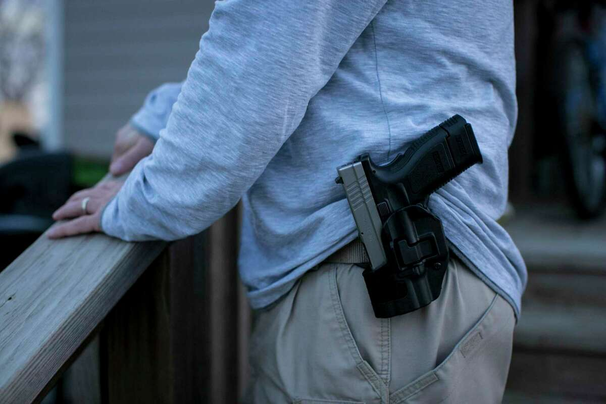 """C.J. Grisham, whose group Open Carry Texas is planning to celebrate their new right to wear guns in hip- or shoulder holsters, in Temple, Texas, Dec. 30, 2015. A law allowing Texans with concealed carry permits to wear guns openly goes into effect on Jan. 1. """"I think most people can expect Friday to be just like Thursday,"""" said Grisham, a retired Army sergeant. (Ilana Panich-Linsman/The New York Times)"""
