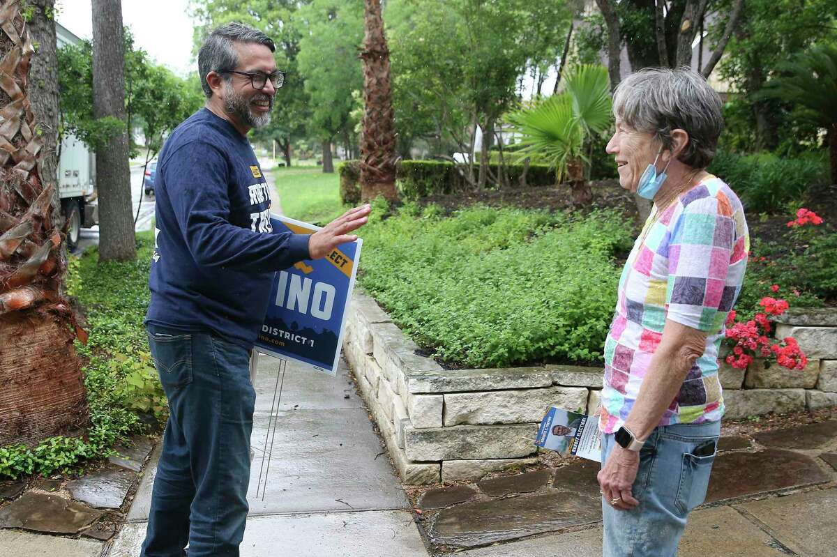 District 1 Councilman Roberto Treviño, who is in a runoff with challenger Mario Bravo, chats with a resident in a Monte Vista neighborhood.