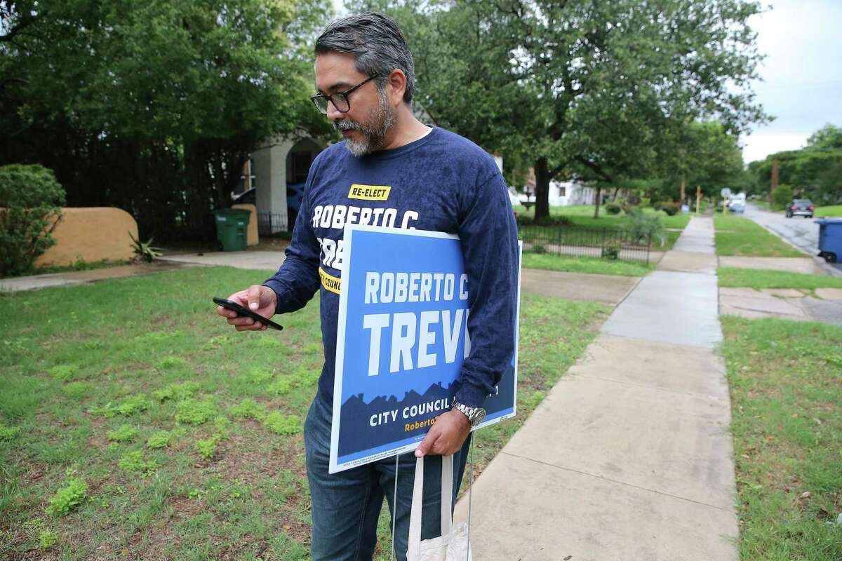 District 1 Councilman Roberto Treviño, who is in a run-off with candidate Mario Bravo, block walks in a Monte Vista neighborhood.