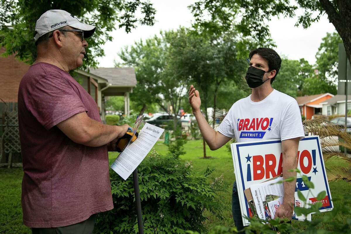 San Antonio City Council District 1 candidate Mario Bravo, right, addresses concerns raised by Hector Cabello.