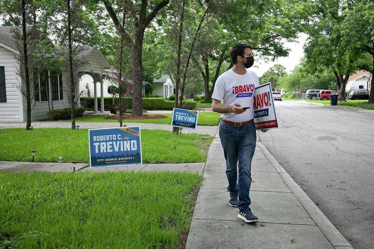 San Antonio City Council District 1 candidate Mario Bravo looks for an address as he blockwalks in San Antonio on May 18, 2021.