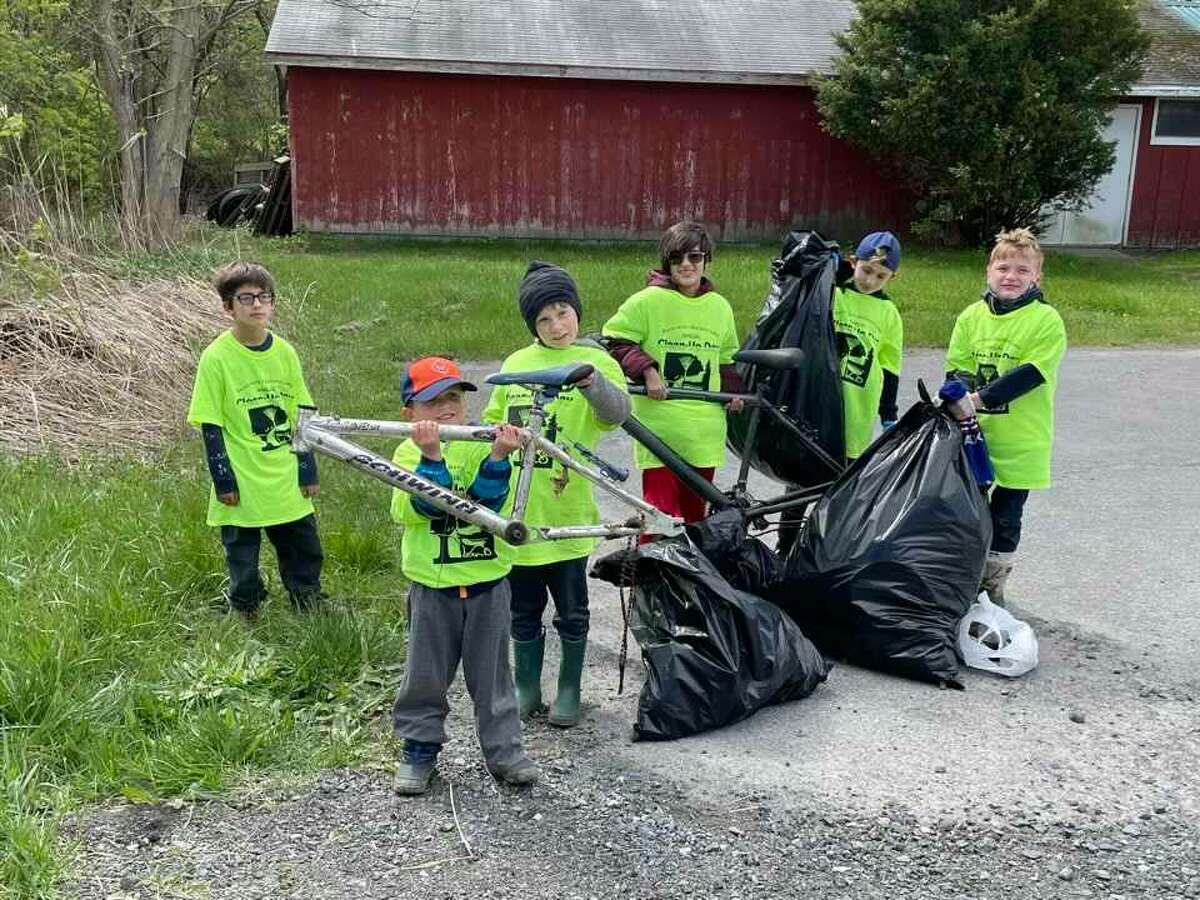 Members of Ballston Lake Cub Scout Pack 83 volunteered, along with some 72 other volunteers and scout troops at Burnt Hills-Ballston Lake Clean Up Day, which began in the early 1970's as a grass roots, educational, environmental initiative. The major sponsors are the Ballston Lake Improvement Association and the BH-BL Business and Professionals Association. (Joann Devoe)
