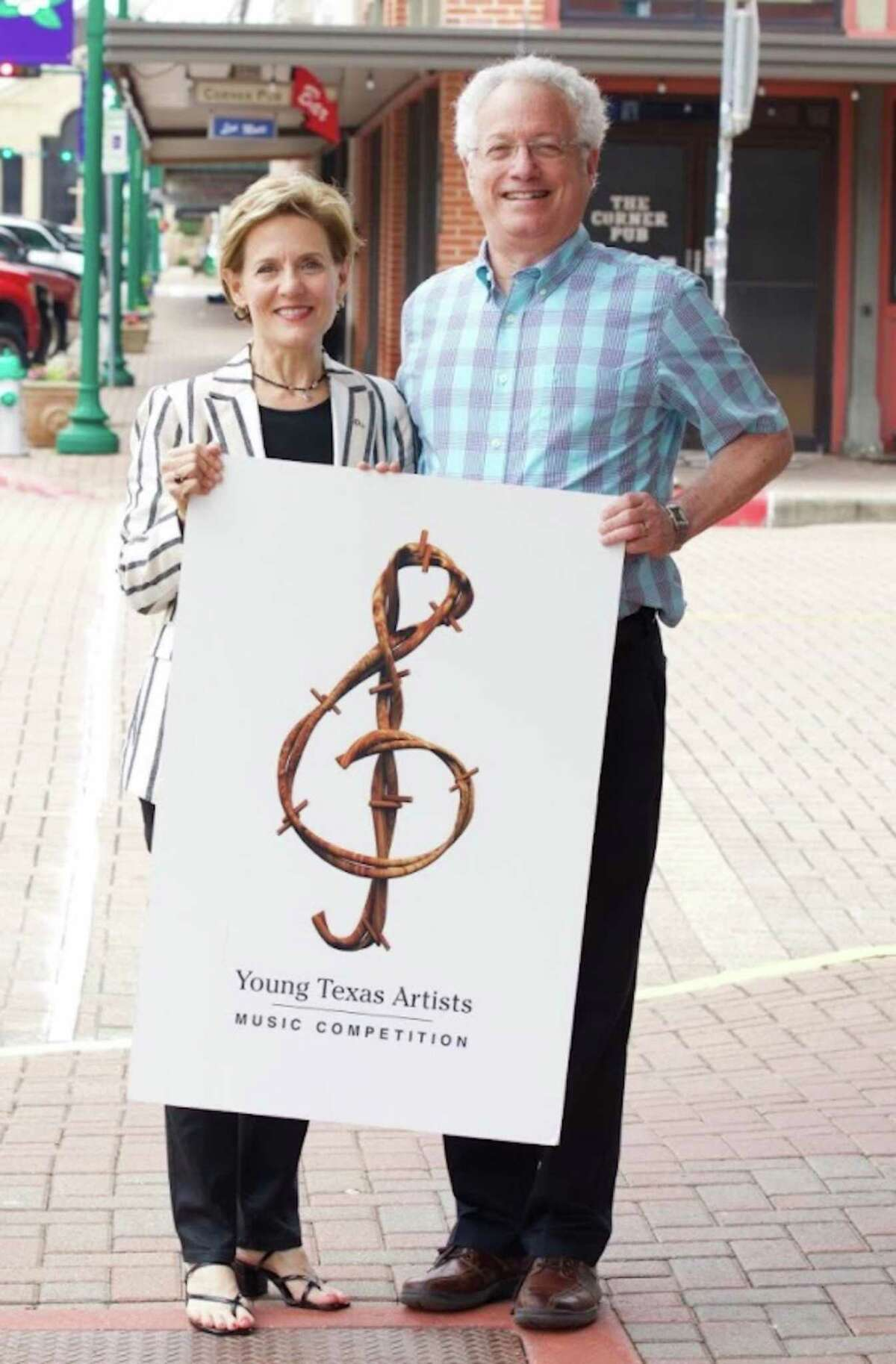 Susie Moore Pokorski, President/CEO of Young Texas Artists (YTA), and Leland Dushkin, Treasurer, jubilant after YTA met its $50,000 Matching Grant Challenge.