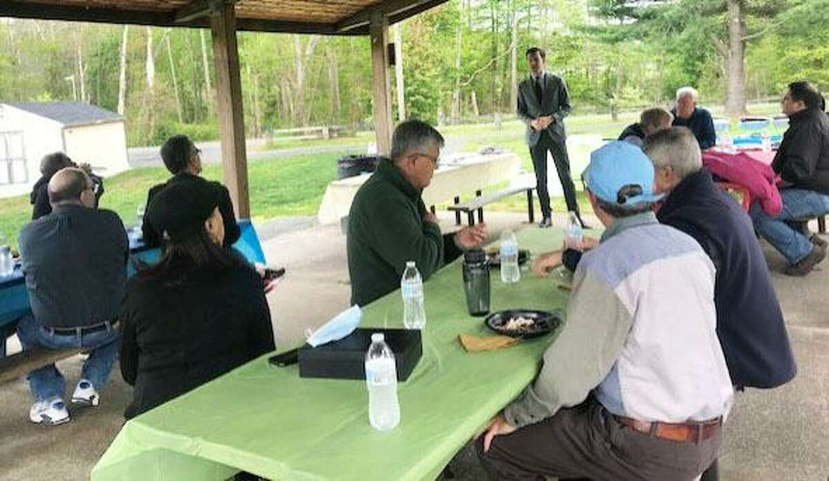 Middletown Mayor Ben Florsheim speaks during a recent wrap-up session for participants of the Middlesex Volunteer Income Tax Assistance program at Veterans Memorial Park.