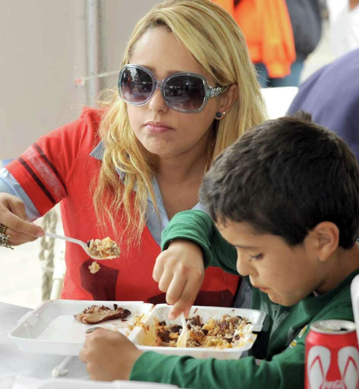 Roberta Maia of Danbury shares a Brazilian dish with her son Caleb, 8, at the Taste of Danbury Sunday, Sept. 12, 2010.