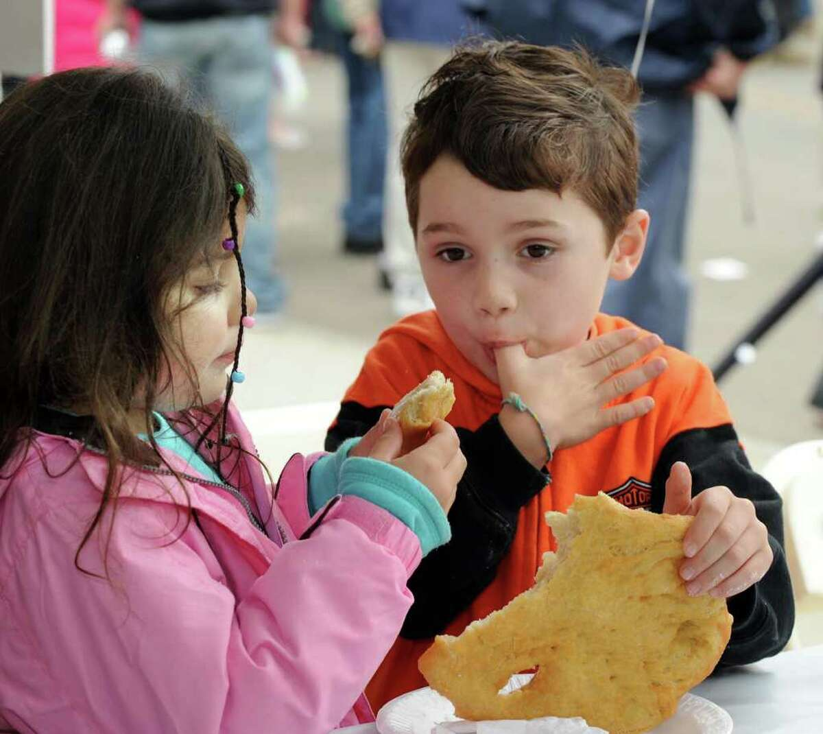 Twins Jordan and Marcus Dupree of Danbury share a fried dough at the Taste of Danbury Sunday, Sept. 12, 2010.