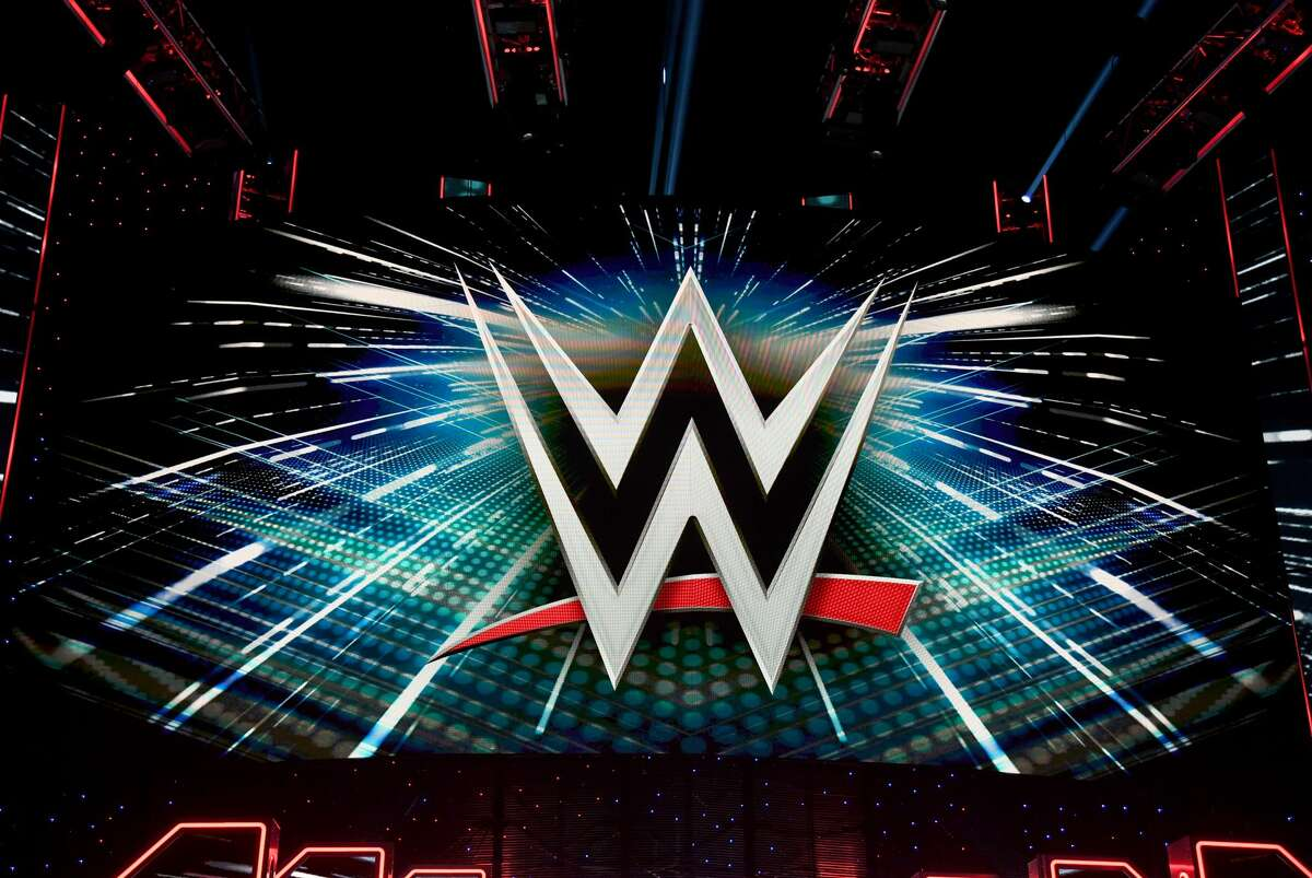 A WWE logo is shown on a screen before a WWE news conference at T-Mobile Arena on October 11, 2019 in Las Vegas, Nevada.