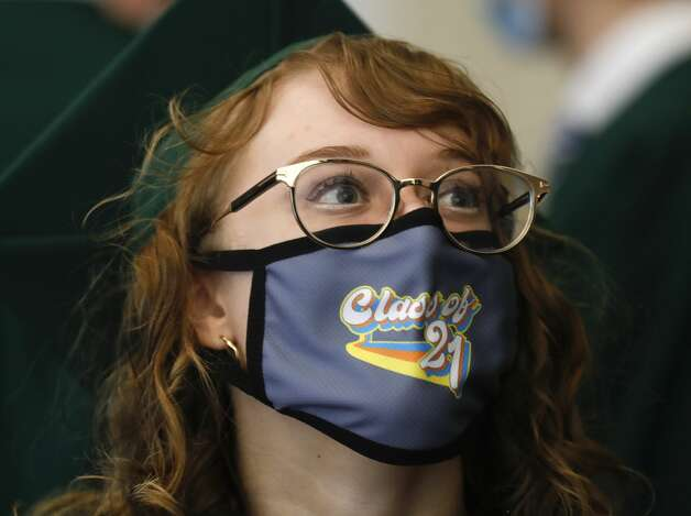Ally Coulton wears a 'Class of 2021' facemask before a John Cooper School graduation ceremony, Friday, May 21, 2021, in The Woodlands. Photo: Jason Fochtman/Staff Photographer / 2021 © Houston Chronicle