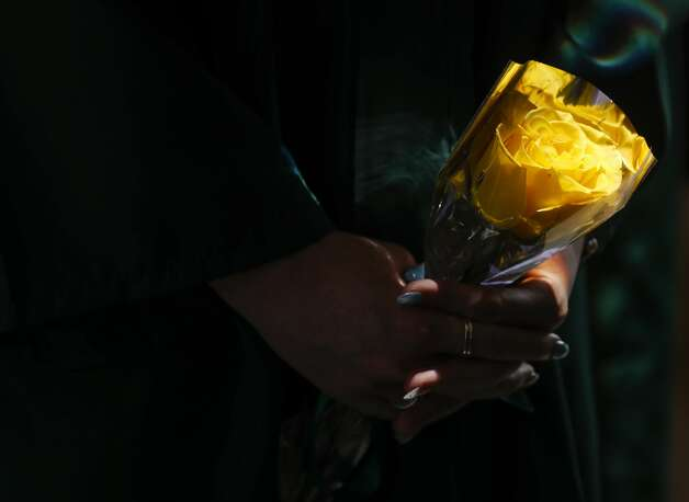 Abby Prettyman holds a yellow rose gives to female students before a John Cooper School graduation ceremony, Friday, May 21, 2021, in The Woodlands. Photo: Jason Fochtman/Staff Photographer / 2021 © Houston Chronicle