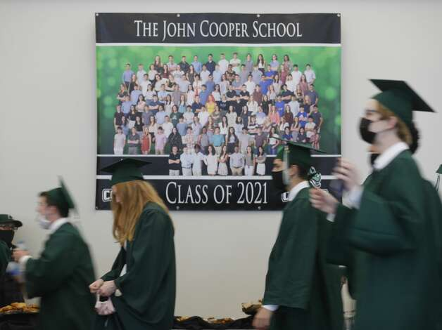 John Cooper students line up before a graduation ceremony, Friday, May 21, 2021, in The Woodlands. Photo: Jason Fochtman/Staff Photographer / 2021 © Houston Chronicle