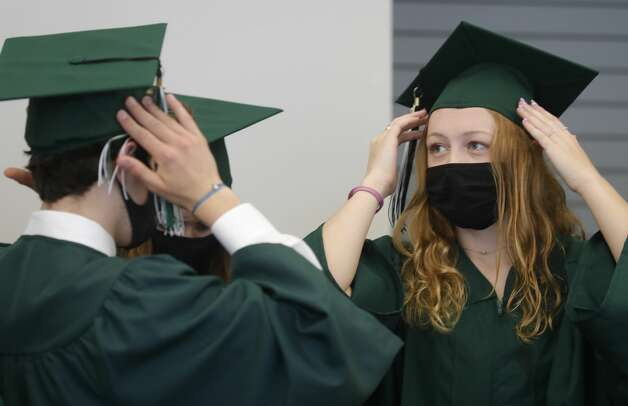 Ryan Hearnsberger, left adjusts his cap before Ruby Herman before a John Cooper School graduation ceremony, Friday, May 21, 2021, in The Woodlands. Photo: Jason Fochtman/Staff Photographer / 2021 © Houston Chronicle