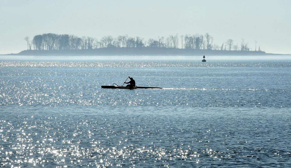 A kayaker paddles on Long Island Sound between Gulf Beach and Charles Island in Milford on February 4, 2019.