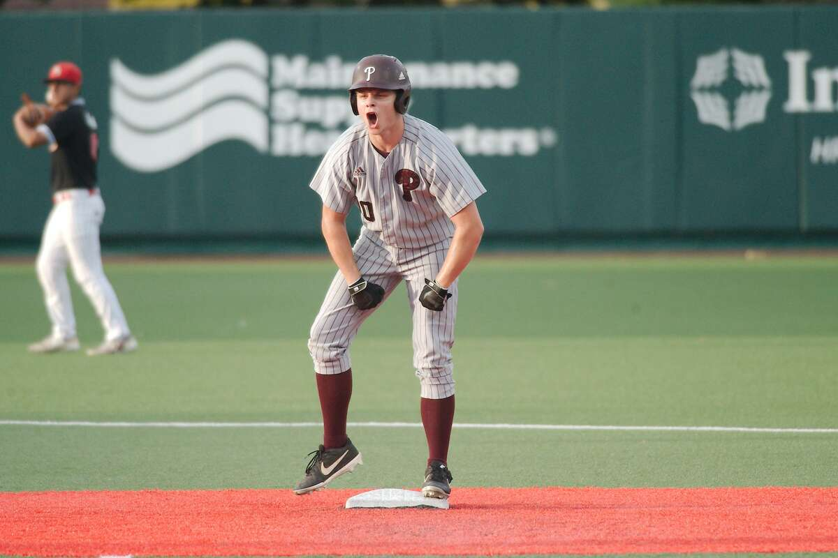 Pearland's Conner DeLeon (10) celebrates a base hit against North Shore Thursday, May 20 at the University of Houston.