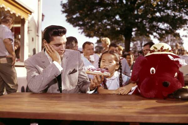 American singer, actor Elvis Presley and Philippine actress Vicky Tiu on the set of It Happened at the World's Fair directed by Norman Taurog. (Photo by Sunset Boulevard/Corbis via Getty Images)