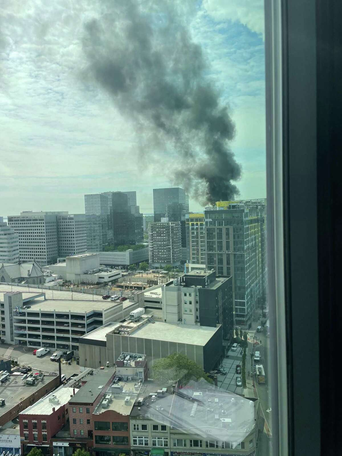 The blaze atop of the roof of a Stamford high-rise that is under construction could be seen across the city Friday morning.