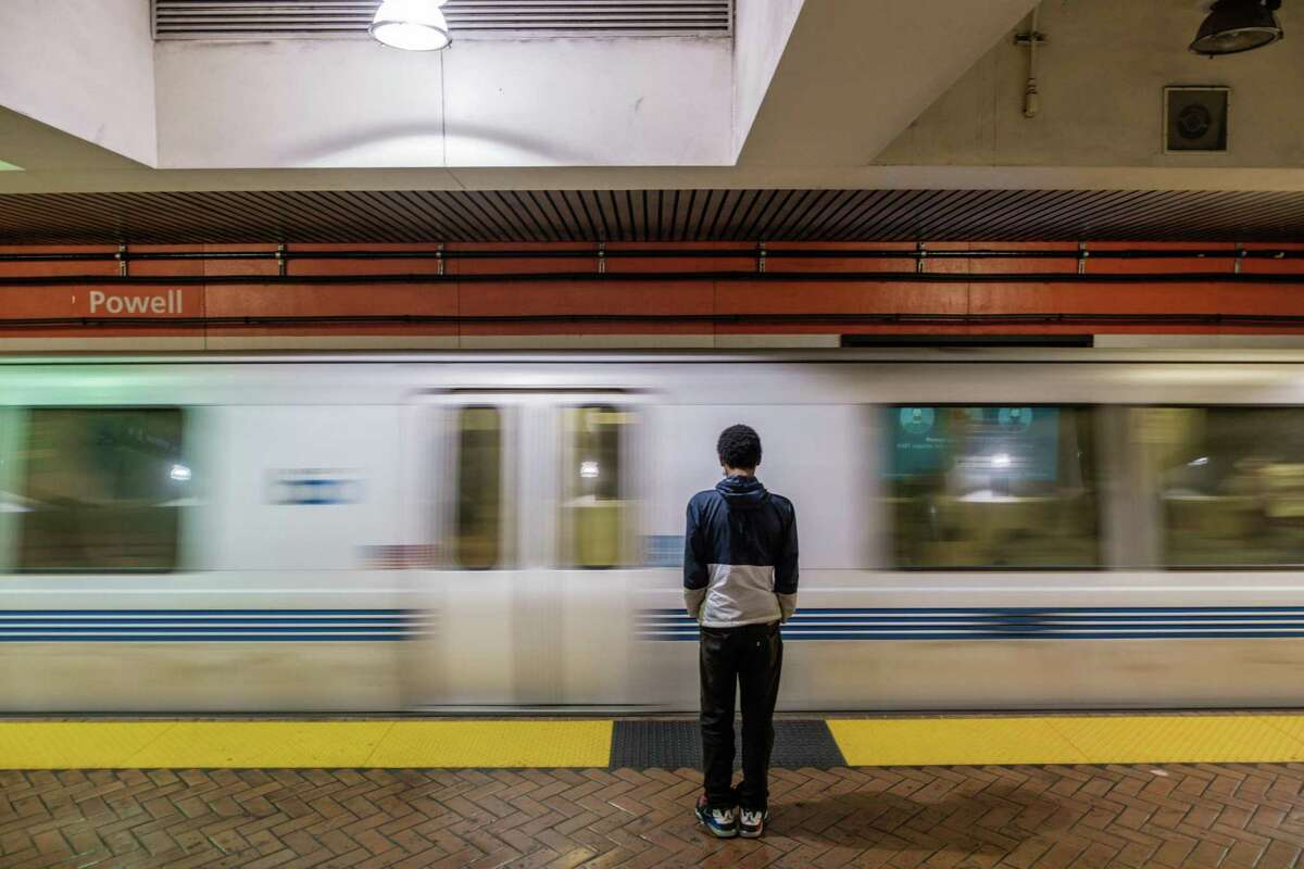 A passenger waits for a BART train at the Powell Street Station in San Francisco. A woman tethered to her dog was dragged and killed at the station when she got of the train but the dog didn't.