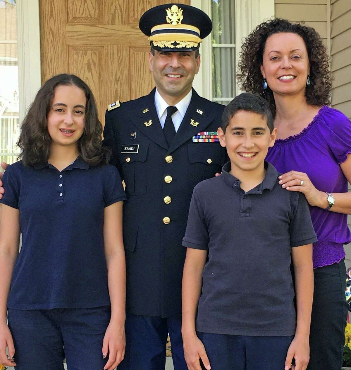 Lt. Col. Tom Saadi, state commissioner of veterans affairs, with his wife, Valerie and his twin children, Sabrina and Jacob.