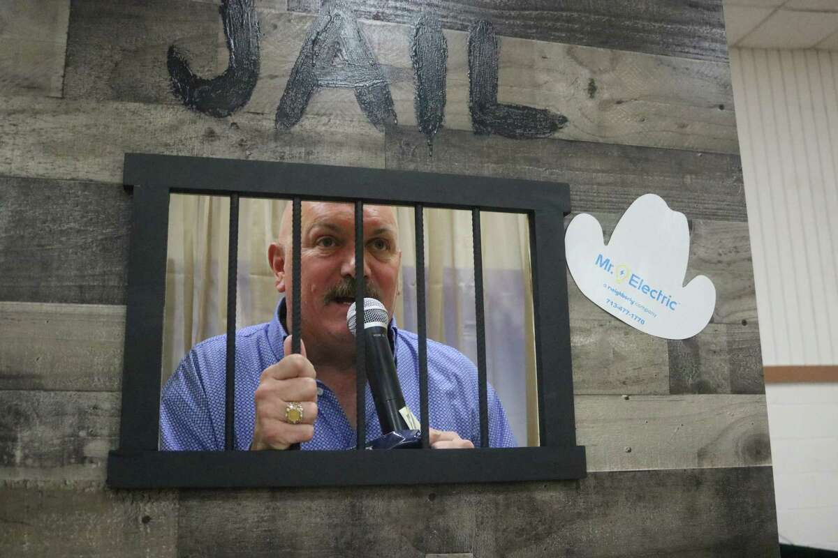 Former Deer Park Chamber of Commerce President Tim Culp finds himself in the Chamberville jail during the annual business expo.