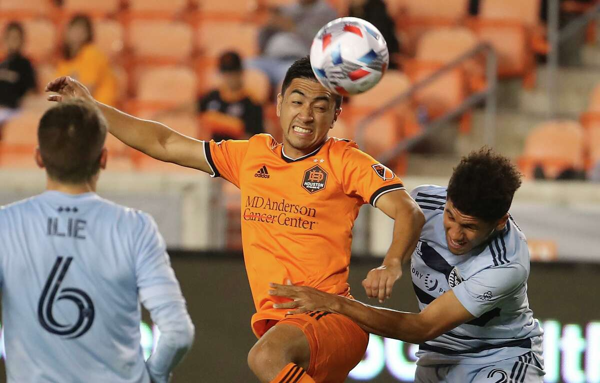 Dynamo coach Tab Ramos wants to see more from midfielder Memo Rodriguez, heading the ball against Sporting KC.